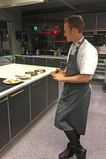 Head chef Jonas Modell assessing the dishes prepared by the four competing teams, giving credits for taste, presentation and teamwork