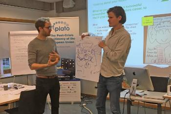 Philipp Lausberg and Joris Melman with their group's version of a researcher